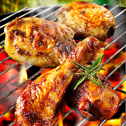 Barbecue chicken legs & thighs on a barbecue grill and bbq sauce