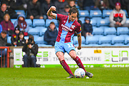 Josh Morris of Scunthorpe United (11) shoots during the EFL Sky Bet League 1 match between Scunthorpe United and Bradford City at Glanford Park, Scunthorpe, England on 27 April 2019.