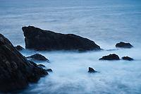 Waves crash against rugged coastline at Butt of Lewis, Isle of Lewis, Western Isles, Scotland