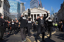 London, UK. 2nd September, 2021. Extinction Rebellion Burning Ballroom dancers perform in front of the Bank of England on the eleventh day of Impossible Rebellion protests. Their performance was intended to highlight 'the wilful ignorance of those in power while the world burns'. Extinction Rebellion are calling on the UK government to cease all new fossil fuel investment with immediate effect.