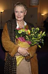 Actress Dame Judi Dench after the nominations announcement for The Orange British Film Academy Film Awards, at which she was nominated for Best Actress for the role of Mrs. Henderson in 'Mrs. Henderson Presents', at 34 Bloomsbury Street, central London on Thursday 19 January 2006. PRESS ASSOCIATION Photo. Photo credit should read: Yui Mok / PA