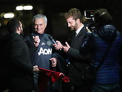 """17.1.18….. Manchester United Manager Jose Mourinho is ambushed by reporters from Italian TV as he arrives back at The Lowry Hotel on Wednesday evening. Alessandro Onnis and Stefano Corti from the show """"Le iene on Italian Tv Channel """"Italia 1 jumped out of their car and ran up the steps of The Lowry Hotel at about 5.15pm and started asking Mourinho questions and he seemed happy enought to talk. When the interview ended they asked Mourinho to sign a Man United shirt, which he did. They then turned the shirt over to reveal that No1 Antonio Conte written on it. Mourinho took the gag in good spirits and walked into the hotel."""