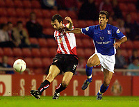 Photo. Jed Wee.<br /> Sunderland v Ipswich Town, Nationwide League Division One, Stadium of Light, Sunderland. 30/09/2003.<br /> Ipswich's Pablo Counago (R) tries to stop Sunderland's Gary Breen.