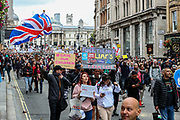"""Anti-lockdown protesters, who believe that the coronavirus pandemic is a hoax, gathered at the 'Unite For Freedom' rally in Trafalgar Square and marched towards Downing Street in central London on Saturday, Aug 29, 2020. Police officers and members of the press wearing face masks who are monitoring the gathering are often shouted at """"take off the Mask"""". (VXP Photo/ Vudi Xhymshiti)"""