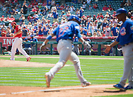 The Cubs' Addison Russell rounds third after hitting a home run off of Angels' starter Matt Shoemaker during their preseason game at Angel Stadium Sunday.<br /> <br /> <br /> ///ADDITIONAL INFO:   <br /> <br /> angels.0404.kjs  ---  Photo by KEVIN SULLIVAN / Orange County Register  --  4/3/16<br /> <br /> The Los Angeles Angels take on the Chicago Cubs at Angel Stadium during a preseason game at Angel Stadium Sunday.<br /> <br /> <br />  4/3/16