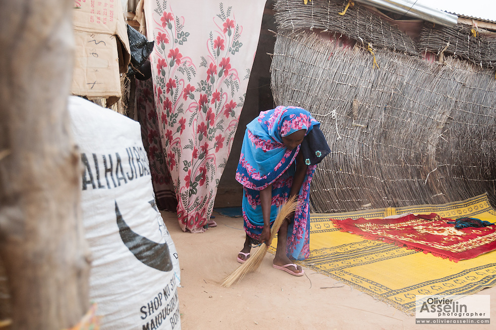 Habsita Moussa, 30, sweeps the courtyard of her home in Mongo, Guera province, Chad on Wednesday October 17, 2012.