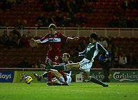 Photo: Andrew Unwin.<br /> Middlesbrough v Liteks Lovech. UEFA Cup. 15/12/2005.<br /> Liteks Lovech' Alejandro Enrique Cichero (R) looks to stop Middlesbrough's James Morrison (L).