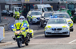 Glasgow, Scotland, UK. 21st October 2021. Final preparations underway at the site of the UN Climate Change Conference COP26 to be held in Glasgow from Oct 31st. Pic;  Police practice high speed escort duties outside the COP26 venue. Iain Masterton/Alamy Live News.