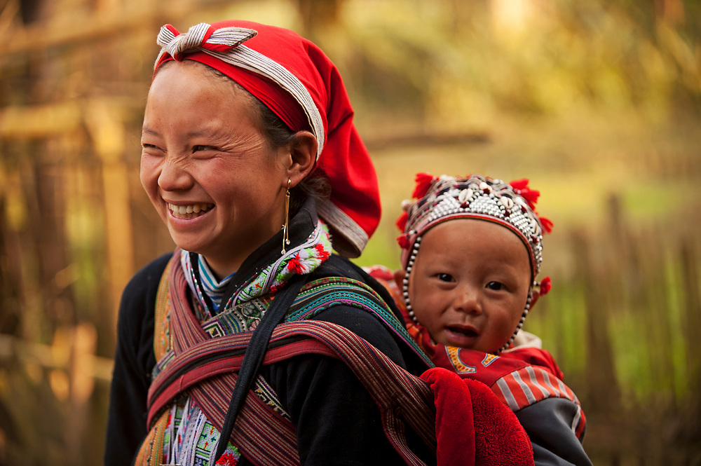 A young mother and her daughter walk through Ma Tra Village in Sapa, Vietnam