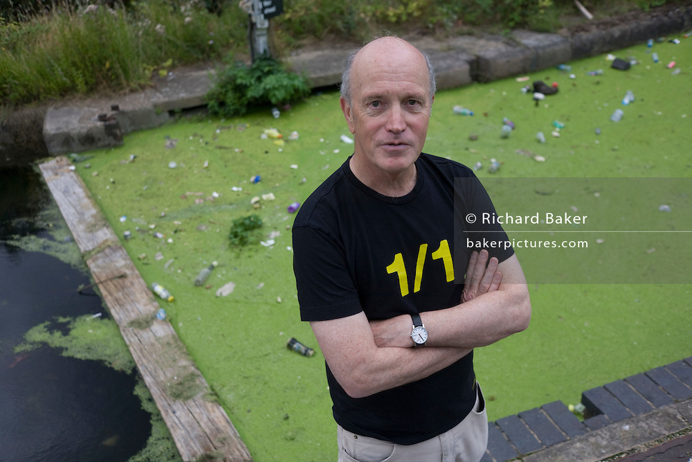 English author/writer Ian Sinclair in his native Hackney, the location for many of his dystopian views on East London. The green waters are in the Regents Canal, filled with algae fed by the materials of the Olympic construction site.