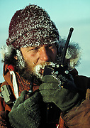 Kiwi dog handler talks into field radio, Ross Ice Shelf, Antarctica