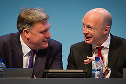 © Licensed to London News Pictures . 23/09/2013 . Brighton , UK . Ed Balls and Liam Byrne talk during the Work and Business Stability and Prosperity session this afternoon (Monday 23rd September 2013) on Work and Business Stability and Prosperity. Day 2 of the Labour Party 's annual conference in Brighton . Photo credit : Joel Goodman/LNP