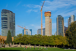 USA, Washington, Bellevue. Downtown skyline with construction of new skyscrapers from Downtown Park.