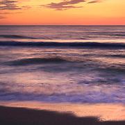 Long exposure of gentle surf with pastel sunset colors. Sanibel Island, FL.