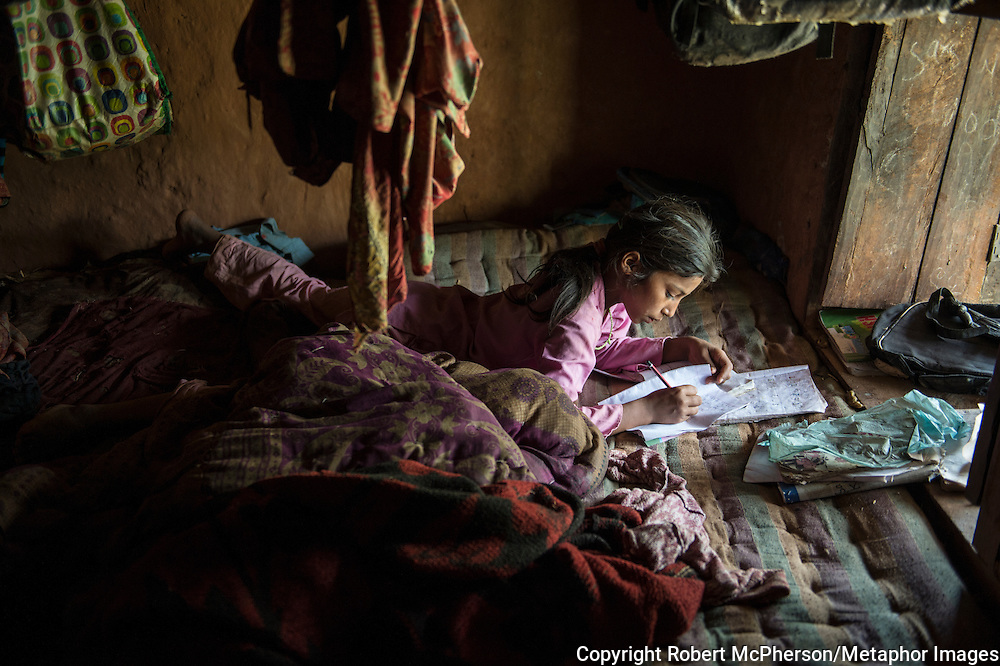 Homework is performed by the window where there is natural light for the Khadka family. On the other side of the river she can see houses lit when it gets darker, but even though their house is only a few kilometers from Kirne Bazar in Khimti, they have been told it is to far way to access electricity. Nepal is the second richest country in water resource but they still meet challenges with building hydropower. Everyday electric current goes off for hours and people are compelled to live in the darkness. Norway is one of the countries who have earned a lot of money on building hydropower in Nepal, but the country itself still remains poor and undeveloped. After the earthquakes that struck Nepal in 2015 the situation is even worse.