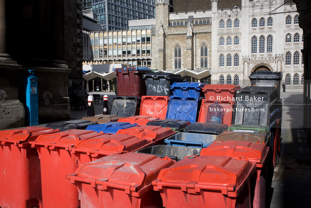 Waste bins arranged in the street opposite the City of London's Guildhall.