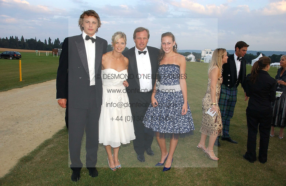 Left to right, HARRY WENTWORTH-STANLEY, his mother The MARCHIONESS OF MILFORD HAVEN, the MARQUESS OF MILFORD HAVEN and his daughter LADY TATIANA MOUNTBATTEN at the Cowdray Gold Cup Golden Jubilee Ball held at Cowdray Park Polo Club, on 21st July 2006.<br /><br />NON EXCLUSIVE - WORLD RIGHTS