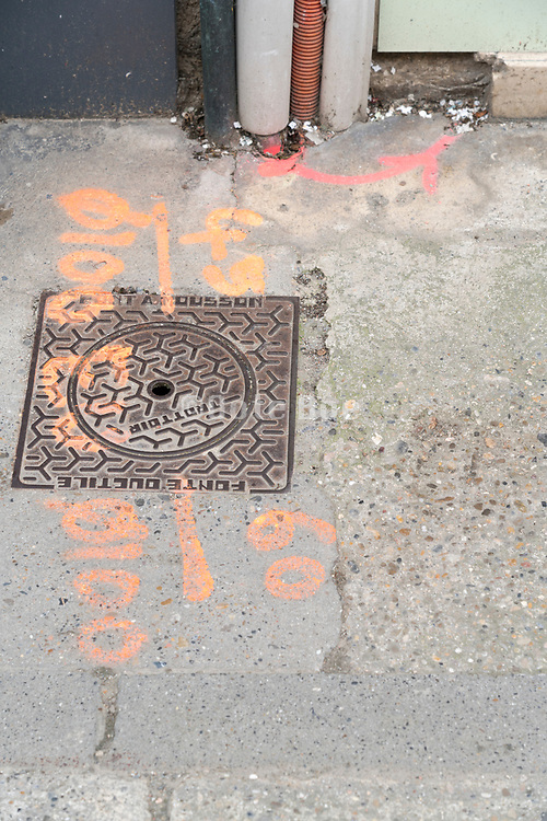 street utilty cover with markings