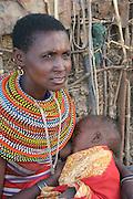 Africa, Tanzania, Samburu Maasai woman and baby an ethnic group of semi-nomadic people February 2006