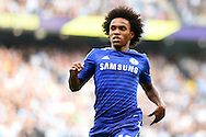 Willian of Chelsea in action. Barclays premier league match, Manchester city v Chelsea at the Etihad stadium in Manchester,Lancs on Sunday 21st Sept 2014<br /> pic by Andrew Orchard, Andrew Orchard sports photography.