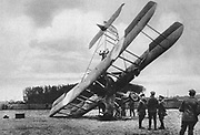 World War I 1914-1918:  A British Vickers biplane that had crashed near Lille, France, being examined by Germans, 1917.  Military, Aircraft, Aviation