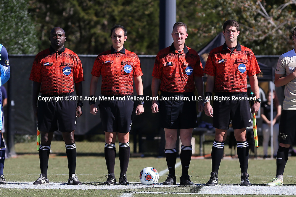 06 November 2016: Match Officials. From left: Assistant Referee Clive Edwards Fourth Official Michael Rhinehart, Referee Mark Gorak, and Assistant Referee Hudson Owens. The Wake Forest University Demon Deacons hosted the University of Notre Dame Fighting Irish at Spry Stadium in Winston-Salem, North Carolina in a 2016 NCAA Division I Men's Soccer match and an Atlantic Coast Conference Men's Soccer Tournament quarterfinal. Wake Forest won the game 1-0.