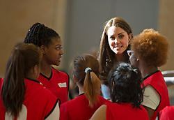 © London News Pictures. 19/01/2015. London, UK. Catherine, Duchess of Cambridge talking to a female youth basketball team as she formally opens Kensington Leisure Centre in West London. Photo credit: Ben Cawthra/LNP
