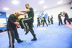 Students kneeing, fighting using the hoops, Stef Noij, KMG Instructor from the Institute Krav Maga Netherlands, takes the IKMS G Level Programme seminar today at the Scottish Martial Arts Centre, Alloa.