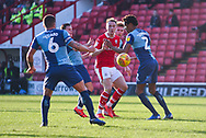 Cauley Woodrow of Barnsley (9) slips a ball through multiple Wycombe defenders during the EFL Sky Bet League 1 match between Barnsley and Wycombe Wanderers at Oakwell, Barnsley, England on 16 February 2019.