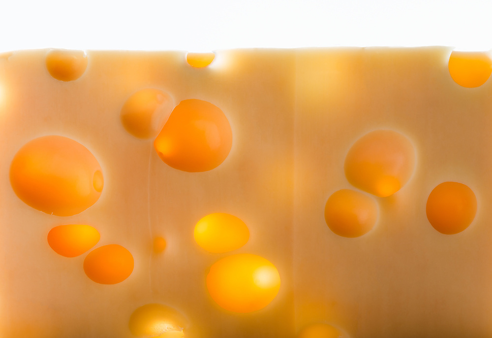 Close-up of a piece of emmental cheese