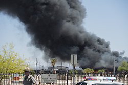 April 27, 2018 - Phoenix, Arizona, U.S - Firefighters work the scene of a fire at a recycling plant near 13th Avenue and Harrison Street in Phoenix, Arizona, on Friday, April 27, 2018. (Credit Image: © Ben Moffat/via ZUMA Wire via ZUMA Wire)