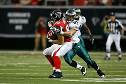 Atlanta Falcons tight end Tony Gonzalez #88 is tackled by Philadelphia Eagles linebacker Chris Gocong #57 during the NFL game between the Philadelphia Eagles and the Atlanta Falcons on December 6th 2009. The Eagles won 34-7 at The Georgia Dome in Atlanta, Georgia. (Photo By Brian Garfinkel)