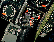 A detailed view of a Mark 1 Hawk jet belonging to 'Synchro Leader' of the elite 'Red Arrows', Britain's prestigious Royal Air Force aerobatic team. We see the flight controls and instrument panels looking grubby and worn with grey paint rubbed or flaking off. This version of the BAE Systems Hawk is low-tech without computers nor fly-by-wire technology it is one of the most user-friendly modern jets to fly and serves as a first step trainer for pilots to accumulate fast-jet flying hours and who are destined for the most sophisticated of fast military fighters in the future. Their aerobatic displays demands that their workhorse machine must have phenomenal turning circle ability and rate of climb. The team's aircraft are in some cases over 25 years old and their airframes require constant attention, with frequent engineering overhauls needed..