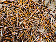16 AUGUST 2017 - BANGKOK, THAILAND: Nails salvaged from scavenged wood after city officials tore down several homes built on pilings in the Wat Thewarat Kunchorn community. The community is one of the 14 riverside communities that will be torn down to make way for a riverfront promenade. Construction of the 14 kilometer long promenade will start in late 2017.           PHOTO BY JACK KURTZ