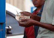 Man holding Kenyan Shilling notes, Kenya