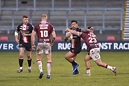 Krisnan Inu (4) of Salford Red Devils hits the tackle of Mitch Clark (23) of Wigan Warriors