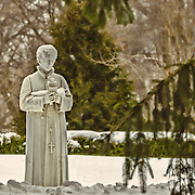 This statue at the Loyola Jesuit Center in Morristown, NJ was sitting in a very quiet spot where it conveys the quiet and spirituality of the center.  On the day that I took this picture, it was very cold with a new layer of snow.