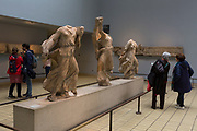 Visitors admire the Greek Three Nereids (390-380BC) in the British Museum, on 11th April 2018, in London, England.