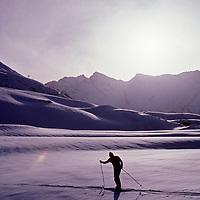 Great Himalaya Range, Kashmir, India. Mountaineer cross country skis around camp in Warwan Valley during two-week Himalayan crossing.