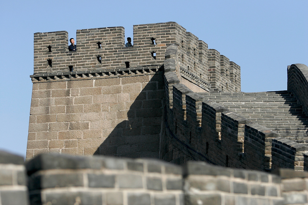 Visitors look out of a watch tower at the top of The Great Wall at Badaling.