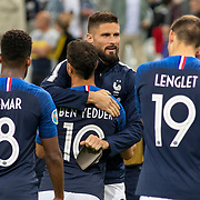 PARIS, FRANCE - September 10:  Wissam Ben Yedder #10 of France is congratulated on his goal by Olivier Giroud #9 of France at the end of the match during the France V Andorra, UEFA European Championship 2020 Qualifying match at Stade de France on September 10th 2019 in Paris, France (Photo by Tim Clayton/Corbis via Getty Images)