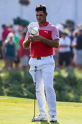 August 10, 2018 - St. Louis, MO, U.S. - ST. LOUIS, MO - AUGUST 10:  Gary Woodland (USA) adjust his hat during Round 2 of the PGA Championship August 10, 2018, at Bellerive Country Club in St. Louis, MO.  (Photo by Tim Spyers/Icon Sportswire) (Credit Image: © Tim Spyers/Icon SMI via ZUMA Press)