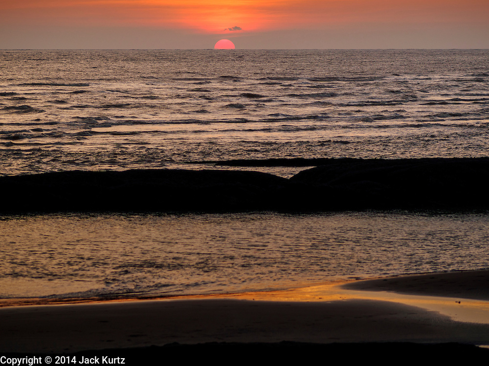 """09 NOVEMBER 2014 - SITTWE, RAKHINE, MYANMAR: The sunset at the """"viewpoint,"""" the southern most point in Sittwe. The viewpoint overlooks the Bay of Bengal. Sittwe is a small town in the Myanmar state of Rakhine, on the Bay of Bengal.  PHOTO BY JACK KURTZ"""
