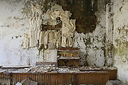 Concert hall with water-damaged Soviet relief sculpture and piano. Pripiat, Ukraine, 2007