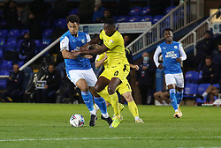 Jonson Clarke-Harris of Peterborough United battles with Lucas Akins of Burton Albion - Mandatory by-line: Joe Dent/JMP - 27/10/2020 - FOOTBALL - Weston Homes Stadium - Peterborough, England - Peterborough United v Burton Albion - Sky Bet League One