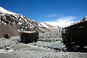Army trucks are crossing a small watercourse to reach one of the many military installations positioned along the Leh-Manali Highway.
