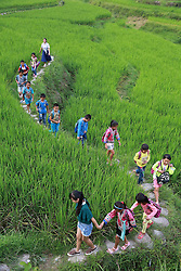 LIUZHOU, Sept. 7, 2016 (Xinhua) -- Liang Haihuan (Back) and Wu Zhongyan (Front) escort their students home from Gaoma Village Primary School, where most students are ''left-behind children'', in Liuzhou, south China's Guangxi Zhuang Autonomous Region. The phrase is used in China to describe rural children whose parents work in other cities. Left-behind children usually live with relatives, often their grandparents, while their parents work away from home. . (Xinhua/Long Tao) (wyl) (Credit Image: © Long Tao/Xinhua via ZUMA Wire)
