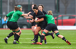 Wales women's Siwan Lillicrap is tackled by Ireland women's Claire Molloy<br /> <br /> Photographer Craig Thomas/Replay Images<br /> <br /> International Friendly - Wales women v Ireland women - Sunday 21th January 2018 - CCB Centre for Sporting Excellence - Ystrad Mynach<br /> <br /> World Copyright © Replay Images . All rights reserved. info@replayimages.co.uk - http://replayimages.co.uk