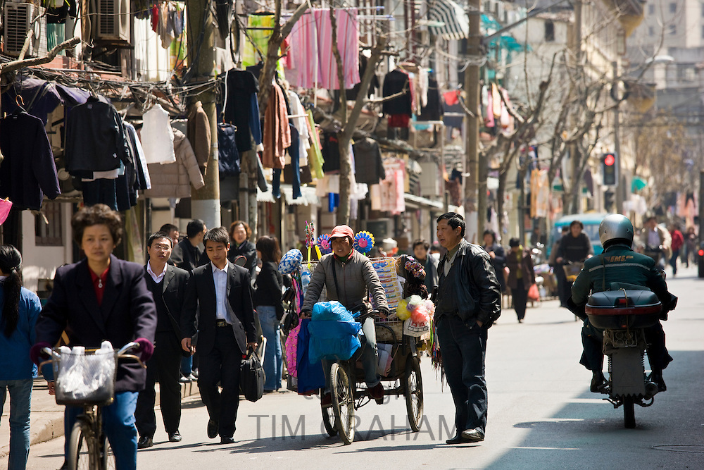 Busy street scene in Zi Zhong Road, old French Concession Quarter in Shanghai, China
