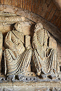 """Early Anglo Saxon sulptures of the Apostles holding books now part of the south porch of Malmesbury Abbey, Wiltshire, England. The apostles, apart from Peter who holds a crude key, have no distinguishing feature to allow identification. Some are holding books, none have halos and some hold their heads at awkward angles. These three styles are typical of Anglo Saxon art. The two panels are 10 ft long and 4ft 6"""" high are date from the original Ango Saxon church of 705. They were probablbly built into the proch during the Norman rebuilding. The style of these sculptures is of the Roman Byzantine style and were probably sculpted by masions from Gaul.  Malmesbury Abbey, Wiltshire, England .<br /> <br /> Visit our MEDIEVAL PHOTO COLLECTIONS for more   photos  to download or buy as prints https://funkystock.photoshelter.com/gallery-collection/Medieval-Middle-Ages-Historic-Places-Arcaeological-Sites-Pictures-Images-of/C0000B5ZA54_WD0s"""
